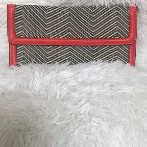 - The limited clutch bag.  -NWT-